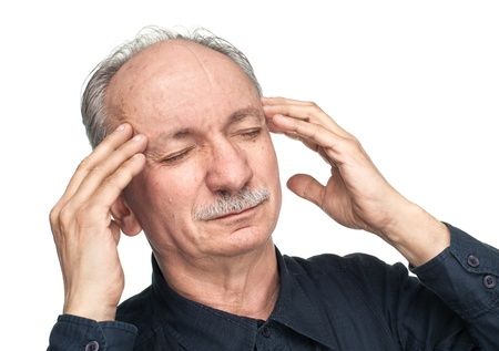 Elderly man suffering from a headache isolated on white photo