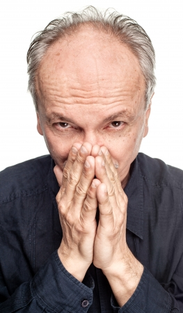 Elderly man covers his face with hand Stock Photo - 16062947