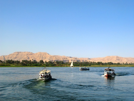 Egyptian boats with tourists on the river Nile near Luxor, Egypt, Africa. photo
