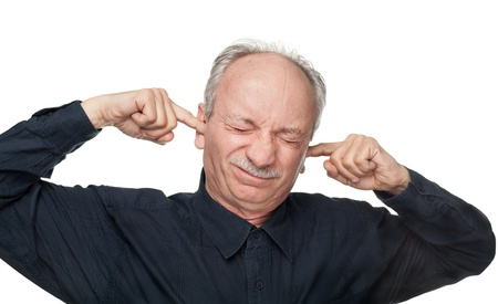 sad old woman: A man covers his ears with his hands. Suffering from a loud sound. Stock Photo