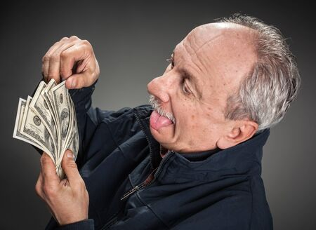 avidity: Greed. Happy man with money