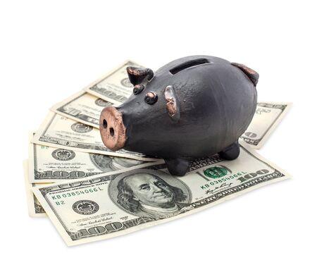 Money and black piggy bank isolated on white background. Stock Photo - 16484193