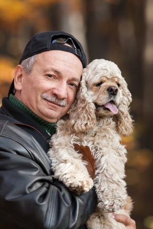 Old man with dog in the forest Stock Photo - 16903872
