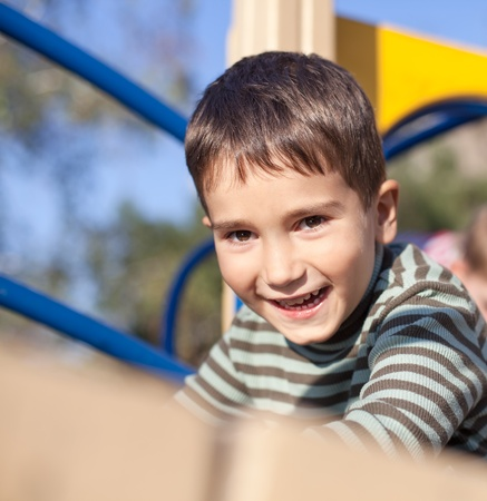 Cute boy playing on the playground Stock Photo - 17424702