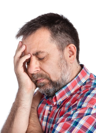 1 man only: Headache. Portrait of an middle age man with face closed by hand. Isolated on white Stock Photo