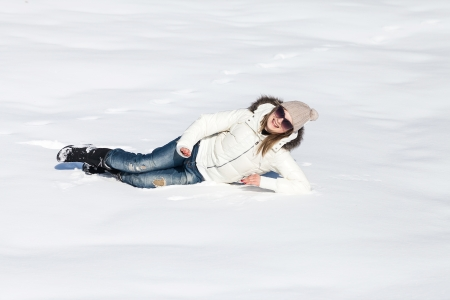 Young woman enjoying winter and playing with snow outdoor photo