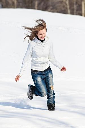 Young woman enjoying winter and playing with snow outdoor Stock Photo - 20045085