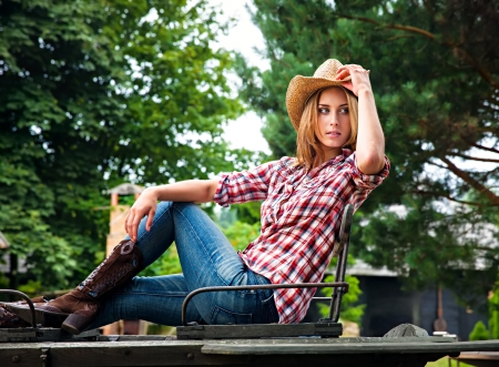 Sexy cowgirl  Young woman portrait in a hat photo