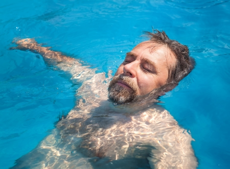 Healthy lifestyle. Middle-aged man in a swimming pool Stock Photo - 21622871