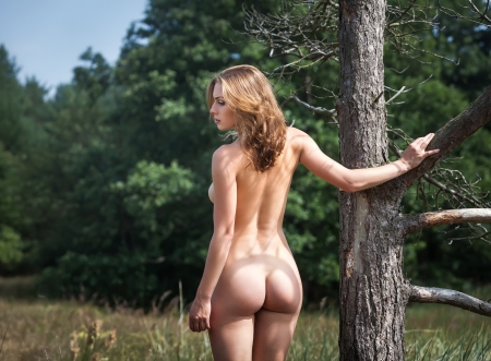 Beautiful Young Naked Woman Outdoors. Enjoy Nature. Stands Near An Old Tree Stock Photo