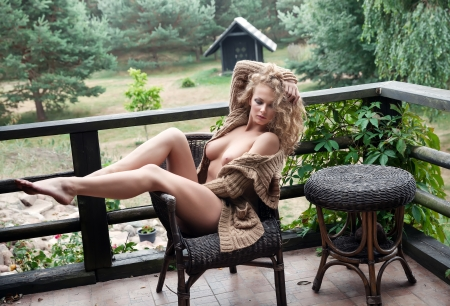 nude breast: Beautiful nude woman posing near the old country house