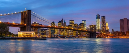 Panorama of Brooklyn Bridge, East River and Manhattan with lights and reflections. New York photo