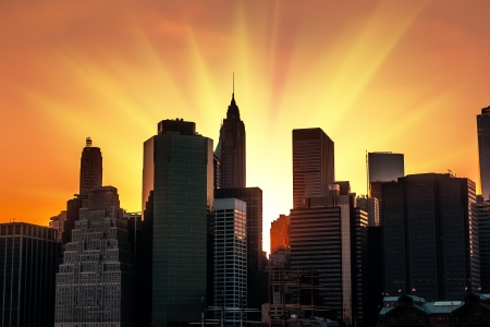 Silhouettes of Manhattan. Sunset in New York City.  photo