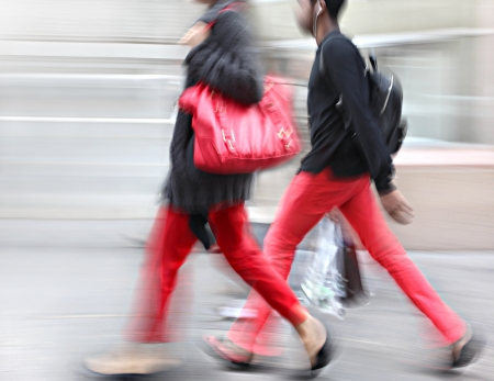 Young people at rush hour walking in the street. Intentional  motion blur Stock Photo