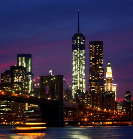 Night at  New York City. Brooklyn Bridge, East River and Manhattan with lights and reflections. Stock Photo