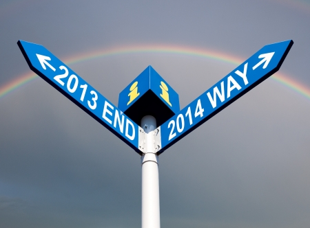 end of rainbow: Street post with 2013 end and 2014 way signs with rainbow Stock Photo