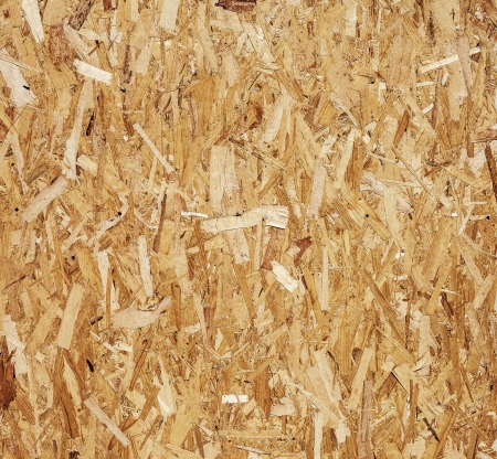 chipboard: Wooden chipboard rough surface texture - detail view