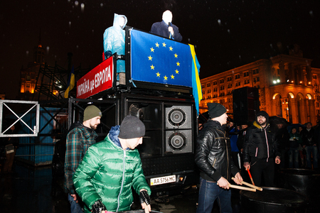 european integration: KIEV, UKRAINE - NOVEMBER 22: People protest at Maidan Nezalezhnosti Square (EuroMaidan) after Ukraine suspended talks with the EU on association