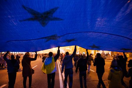 maidan: KIEV, UKRAINE - NOVEMBER 24: EuroMaidan - People protest after Ukraine suspended talks with European Union on association Editorial