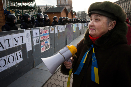 european integration: KIEV, UKRAINE - NOVEMBER 30, 2013: Mass protest against the refusal of the Government of Ukraine on European Integration. November 30, 2013, Kiev Editorial