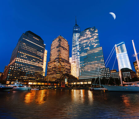 moon  metropolis: World Financial Center at night viewed from the Hudson river, New York, USA