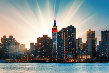 Manhattan skyline at sunset. New York City