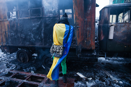 disillusionment: KIEV, UKRAINE - January 20, 2014: The morning after the violent confrontation and anti-government protests on the Hrushevskoho Street