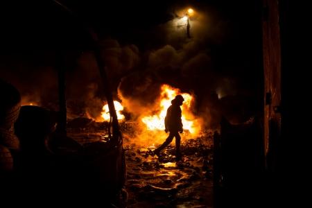 maidan: KIEV, UKRAINE - January 24, 2014: Mass anti-government protests in the center of the Ukrainian capital Kiev. Fire and smoke on the barricades on Hrushevskoho St.