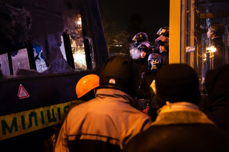outcry: KIEV, UKRAINE - January 24, 2014: Mass anti-government protests in the center of the Ukrainian capital Kiev. Negotiations between resistance fighters and police  on Hrushevskoho St.