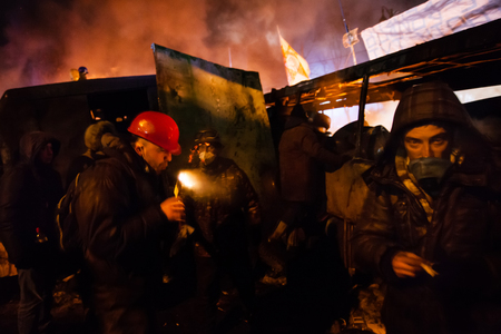 outcry: KIEV, UKRAINE - January 24, 2014: Mass anti-government protests in the center of the Ukrainian capital Kiev. Popular Resistance Warrior preparing to storm by government troops  on Hrushevskoho St.   Editorial
