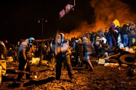 maidan: KIEV, UKRAINE - January 24, 2014: Mass anti-government protests in the center of the Ukrainian capital Kiev. Popular Resistance Warrior preparing to storm by government troops  on Hrushevskoho St.   Editorial