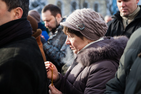 clashes: KIEV, UKRAINE - January 26, 2014: memorial service at St Michaels Cathedral on 25 year old Euromaidan activist Michail Zhiznevsky, belarusian, who was killed in the center of Kiev, Ukraine during clashes with riot police on the street Hrushevskoho
