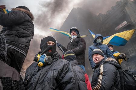 barricades: KIEV, UKRAINE - January 25, 2014: Mass anti-government protests in the center of Kiev. Group of anti-government resistance fighters on the barricades on Hrushevskoho St. Editorial