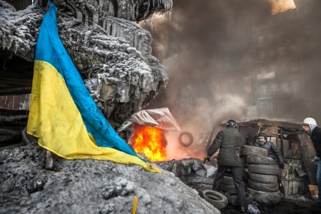 outcry: KIEV, UKRAINE - January 25, 2014: Mass anti-government protests in the center of Kiev. Protesters burn tires in the conflict zone on the Hrushevskoho St.  Editorial