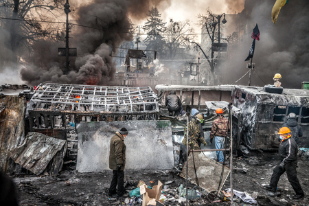 maidan: KIEV, UKRAINE - January 25, 2014: Mass anti-government protests in the center of Kiev. Barricades in the conflict zone on Hrushevskoho St.