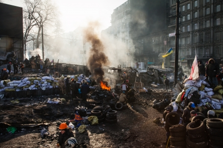 KIEV, UKRAINE - January 26, 2014: Mass anti-government protests in the center of Kiev. Euromaidan protesters rest and strengthen the barricades after night of clashes with riot police Editorial