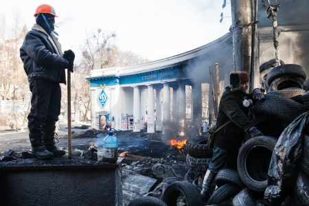maidan: KIEV, UKRAINE - January 26, 2014: Mass anti-government protests in the center of Kiev. Euromaidan protesters rest and strengthen the barricades after night of clashes with riot police Editorial