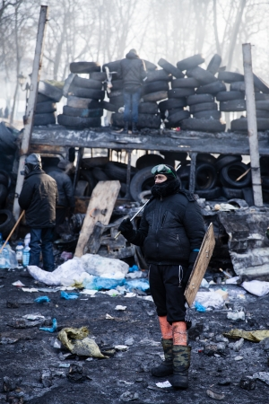 barricades: KIEV, UKRAINE - January 26, 2014: Mass anti-government protests in the center of Kiev. Euromaidan protesters rest and strengthen the barricades after night of clashes with riot police Editorial