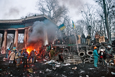 clashes: KIEV, UKRAINE - January 26, 2014: Euromaidan protesters rest and strengthen their barricades on Hrushevskoho Street after another night of clashes with riot police in Kiev, Ukraine.
