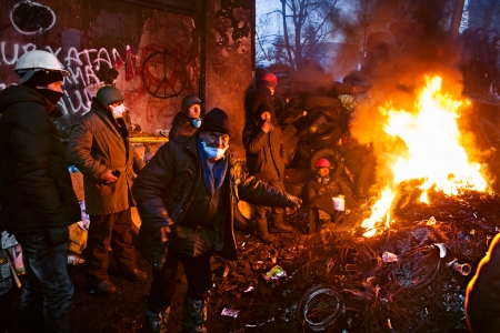 barricades: KIEV, UKRAINE - January 26, 2014: Euromaidan protesters rest and strengthen their barricades on Hrushevskoho Street after another night of clashes with riot police in Kiev, Ukraine.