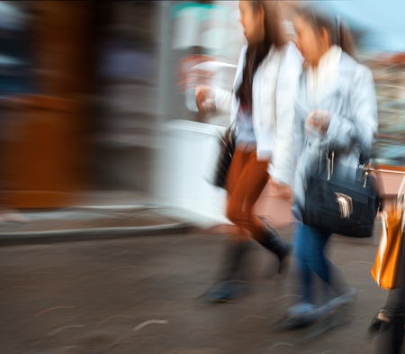 Group of young people hurrying about their business. Intentional motion blur photo