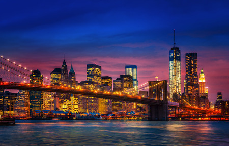 Brooklyn Bridge, East River and Manhattan with lights and reflections. New York