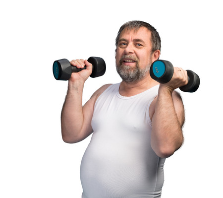 paunch: Middle-aged man with a paunch exercising with dumbbells isolated on white background