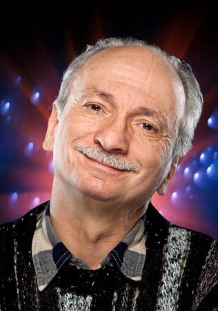 Portrait of happy senior man on a colorful spotted background Reklamní fotografie