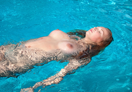 hot girl nude: Beautiful young naked woman in swimming pool