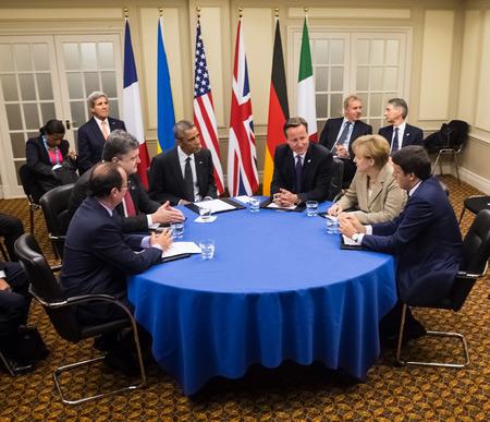 NEWPORT, WALES, UK - Sep 4, 2014: NATO summit.  French President Francois Hollande, President of Ukraine Petro Poroshenko, US President Barack Obama, British Prime Minister David Cameron and German Chancellor Angela Merkel during a meeting on the sideline