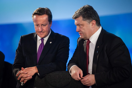 minister of war: NEWPORT, WALES, UK - Sep 4, 2014: President of Ukraine Petro Poroshenko and British Prime Minister David Cameron during a meeting at the NATO summit in Newport (Wales, UK)