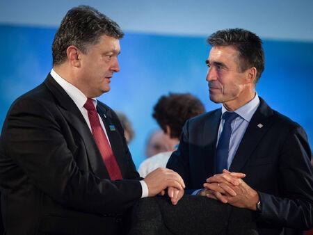 nato summit: NEWPORT, WALES, UK - Sep 4, 2014: President of Ukraine Petro Poroshenko, left, and NATO Secretary General Anders Fogh Rasmussen at the NATO summit in Newport (Wales, UK)