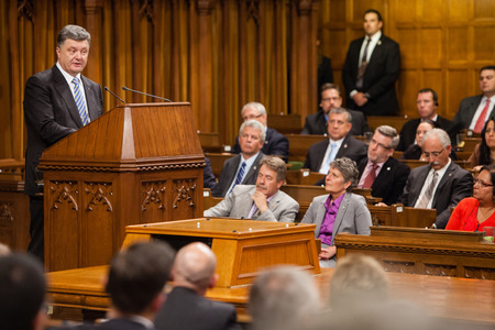 commons: OTTAWA, CANADA - Sep 17, 2014: President of Ukraine Petro Poroshenko during the joint meeting of the House of Commons and the Senate of the Parliament of Canada in Ottawa (Canada) Editorial