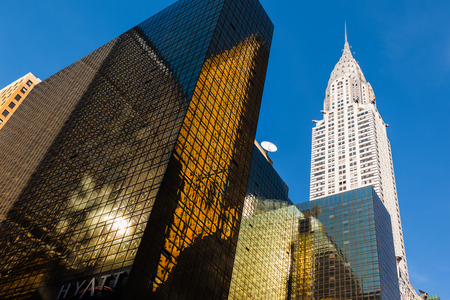 boroughs:  Chrysler building and manhattan modern architecture. Manhattan is the most densely populated of the five boroughs of New York City Stock Photo